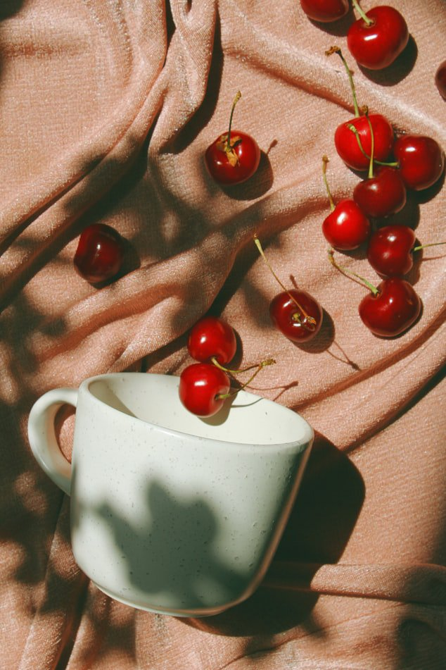 a cup with cherries dispersed juice as a  healthy drink to lower cholesterol