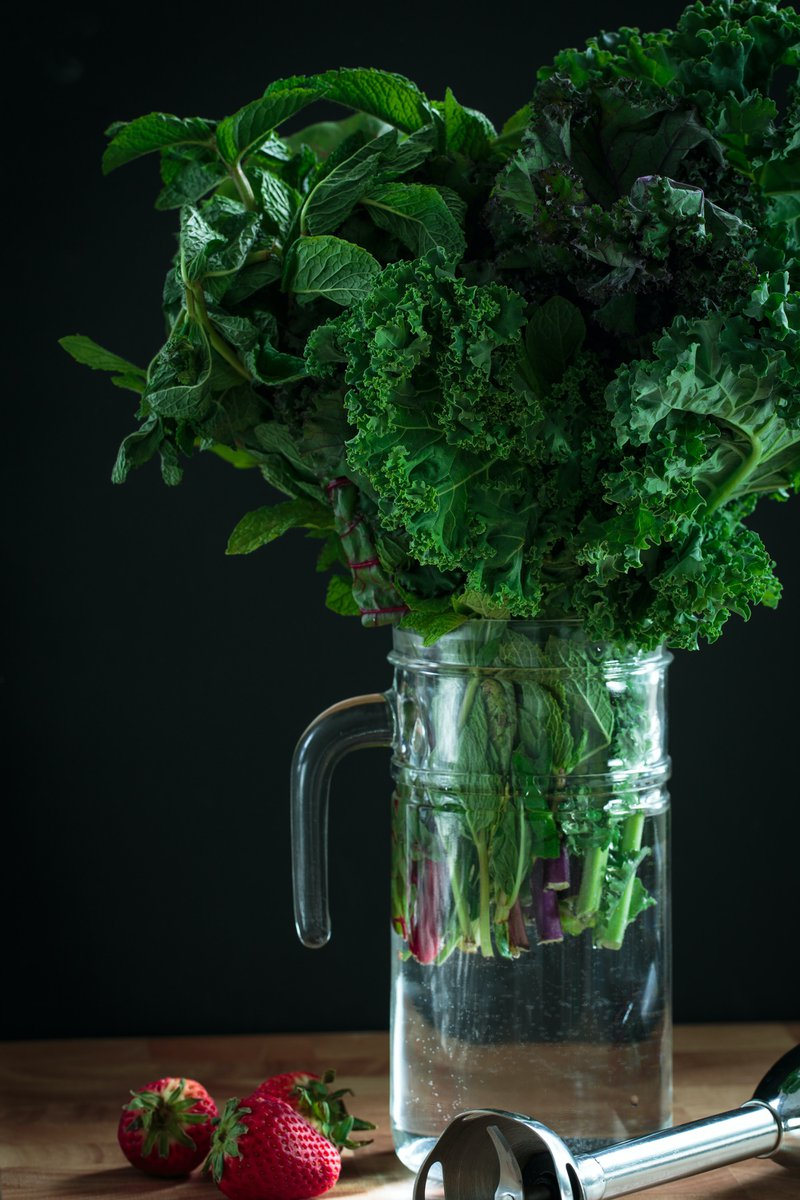 bouquet of kale leaves in a pitcher