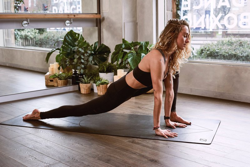 a woman exercising or stretching boost immune system