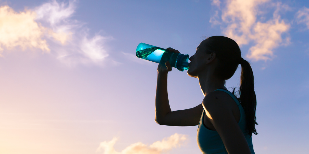 A Picture Of A Girl Drinking Water