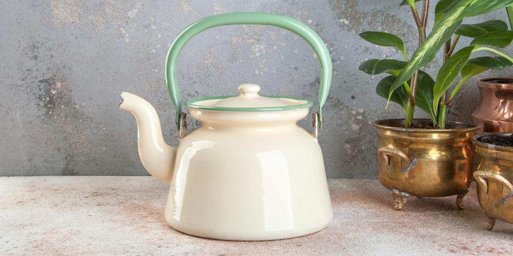 A Photo Of A White Enamel Tea Kettle
