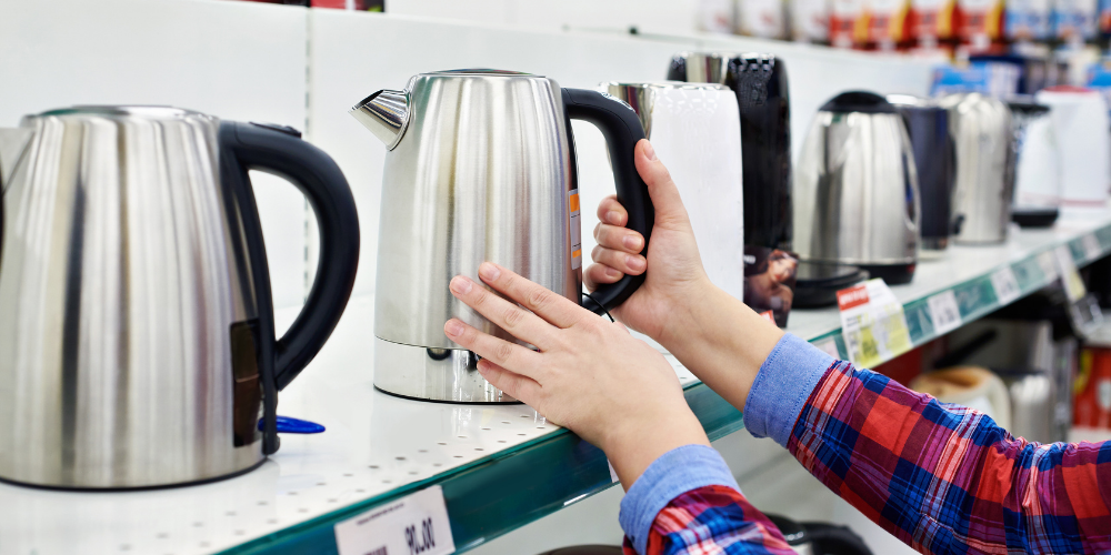 A Person Deciding Which Tea Kettle To Buy