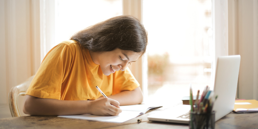 A Photo Of A Young Girl Studying