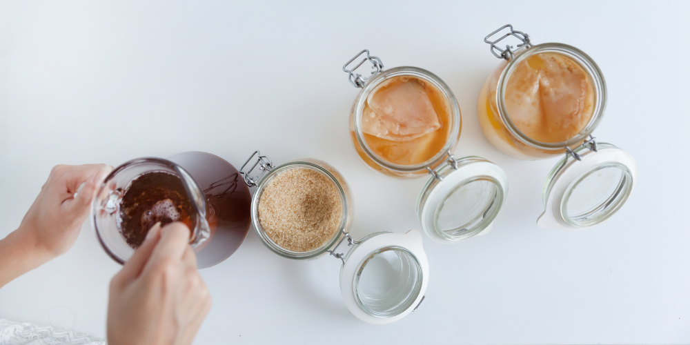 A Person Preparing Kombucha