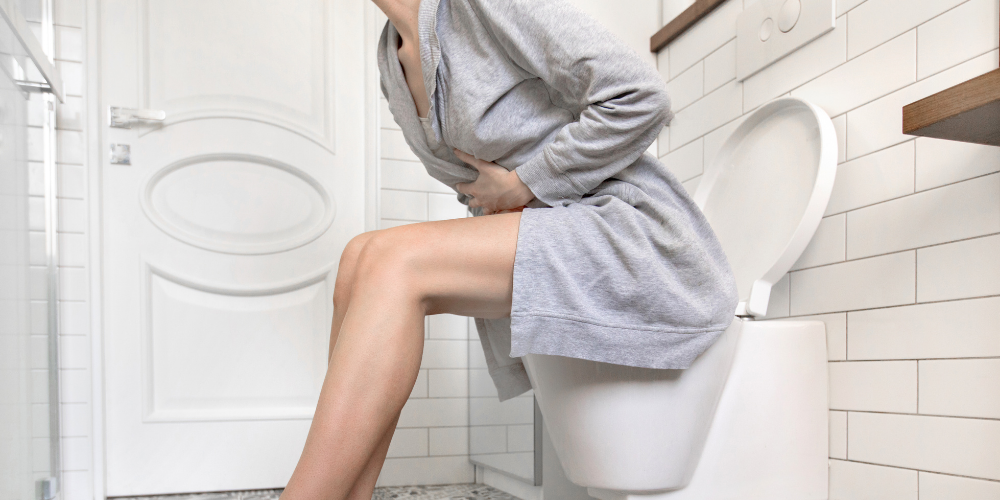 A Photo Of A Woman Suffering With Constipation