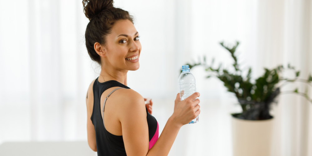 A Photo Of A Woman Holding An Empty Water Bottle