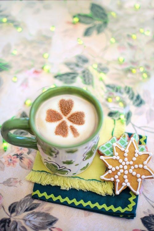 White and Green Ceramic Mug With Coffee
