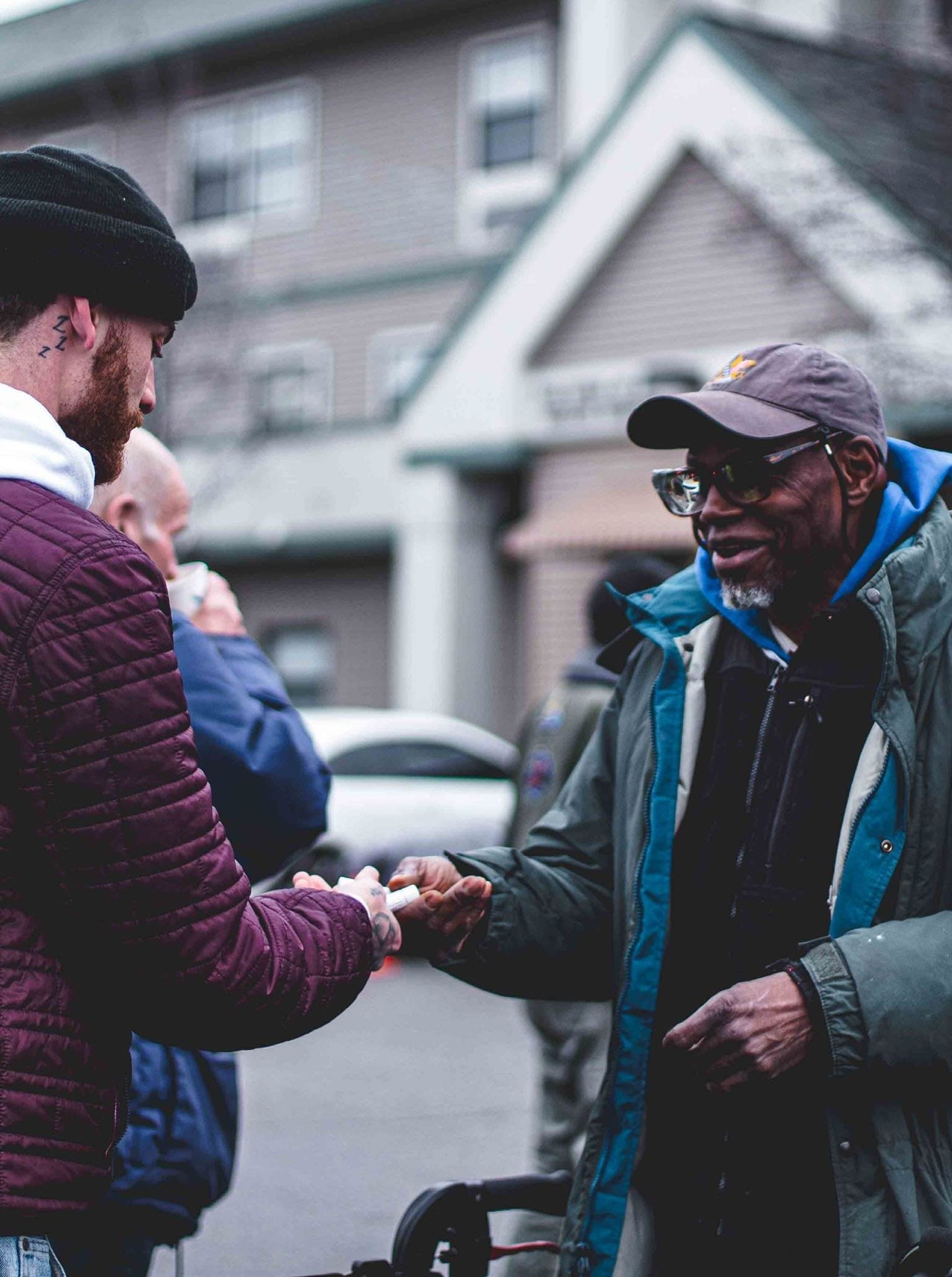 A Neighbor Idaho volunteer giving a man chapstick