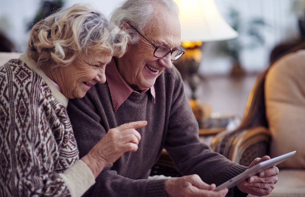 Older couple using video calling on tablet device