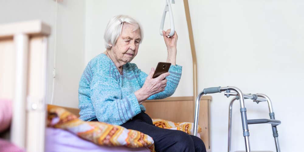 Older person on bed using phone
