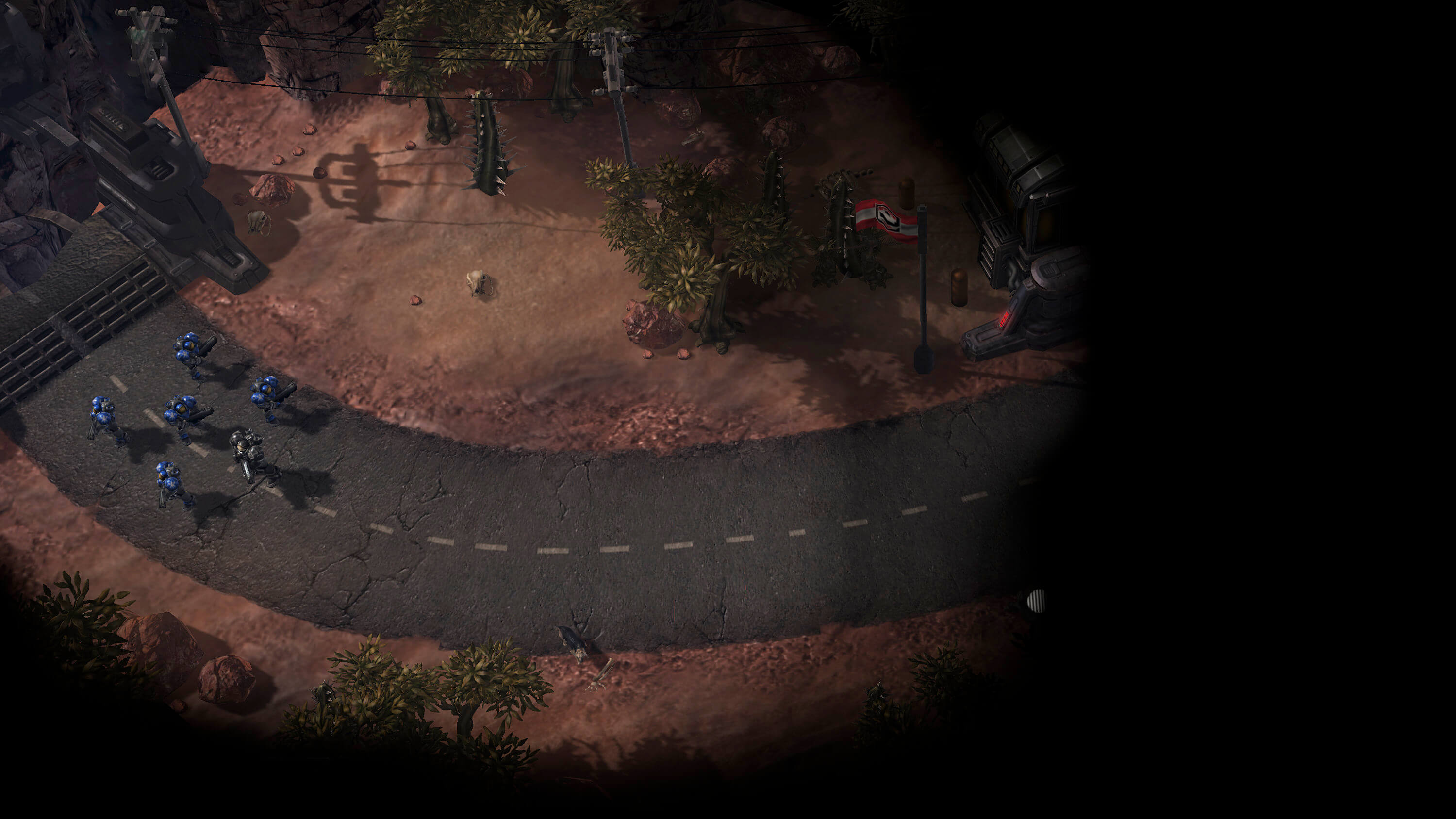 A screenshot from the game Starcraft 2 of infantry advancing down a road toward the dark fog of war