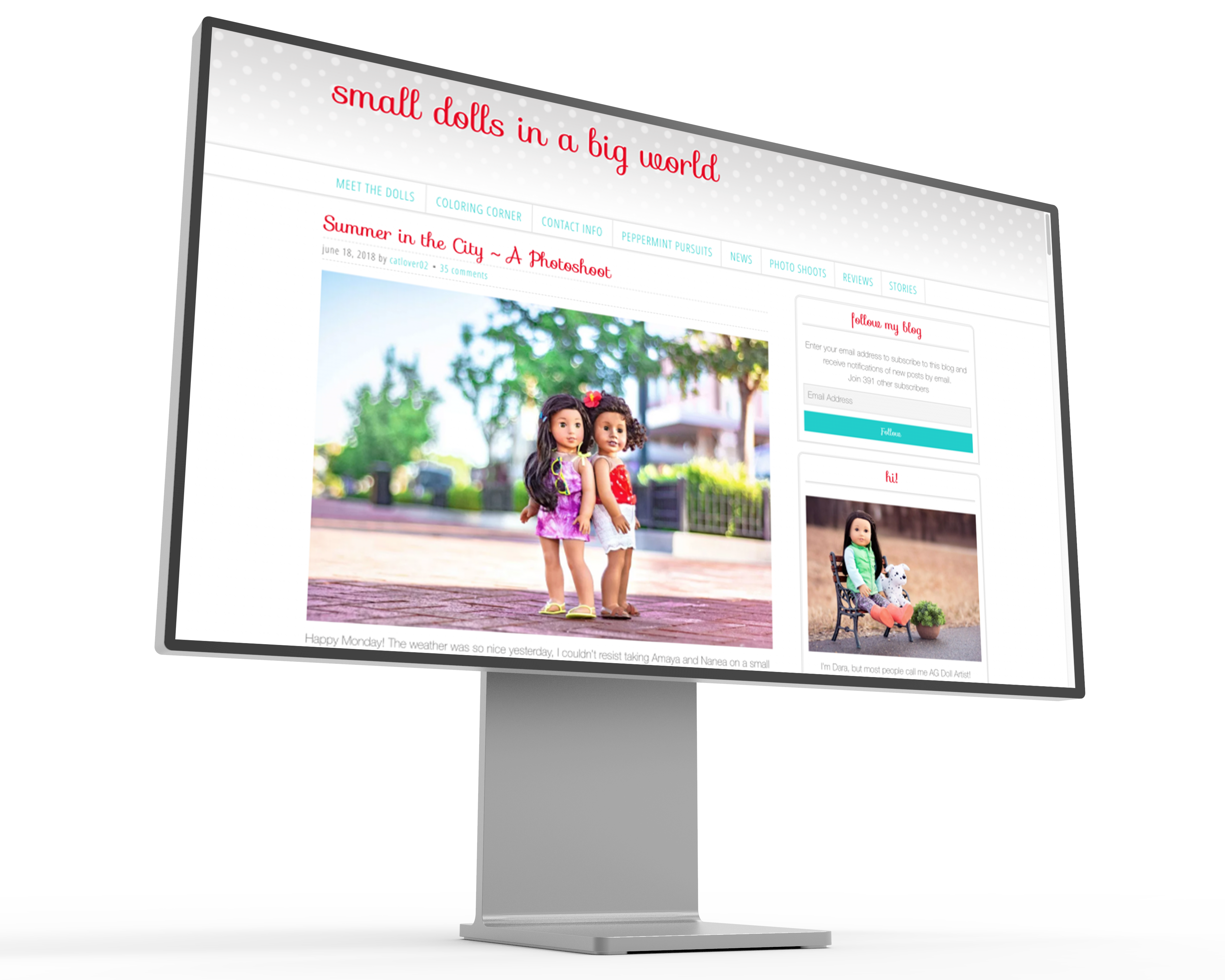 Image of the Small Dolls in a Big World website displayed on a mockup of a Pro XDR Display.