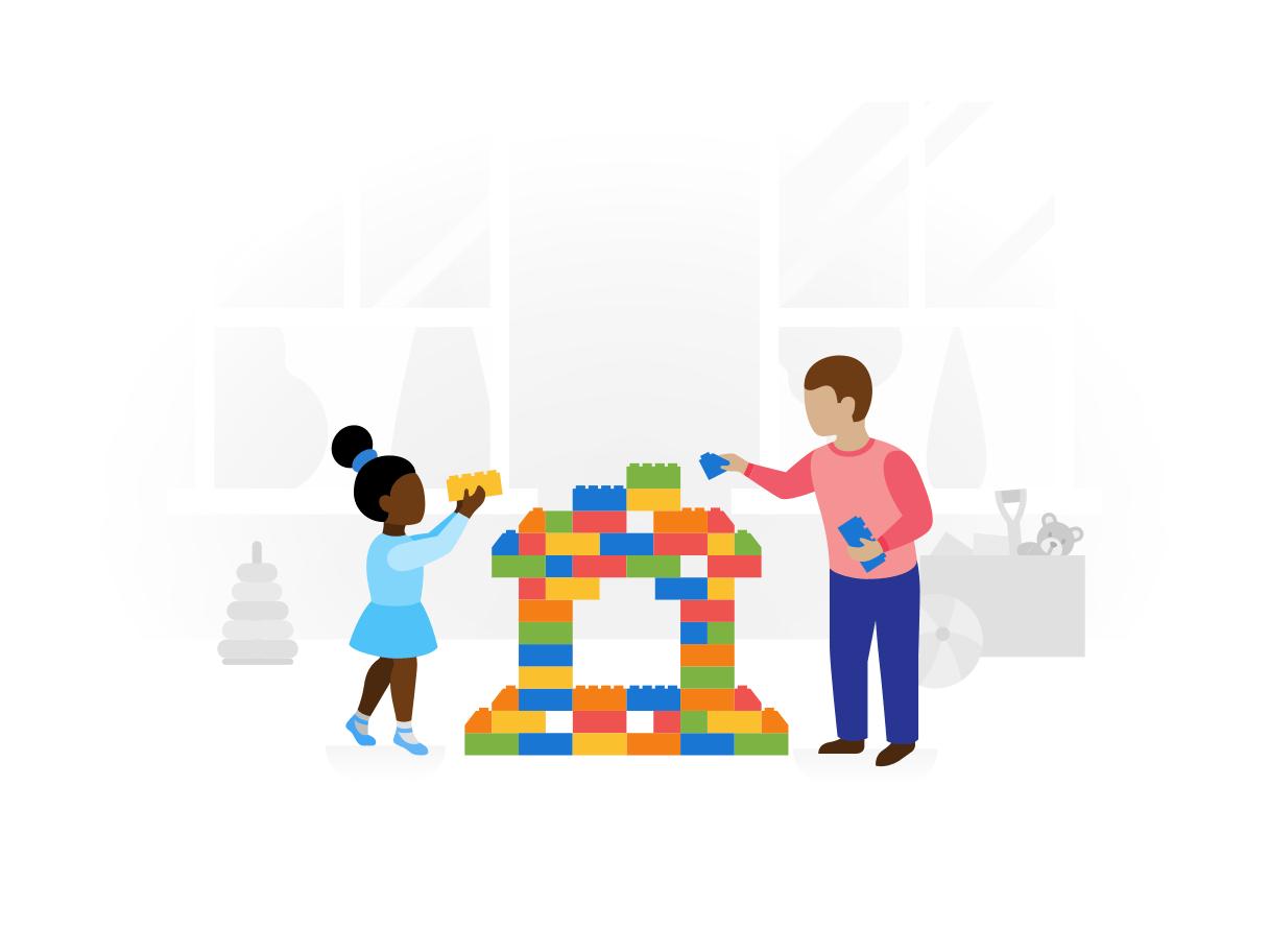 Twee kinderen zijn aan het spelen met gekleurde blokken