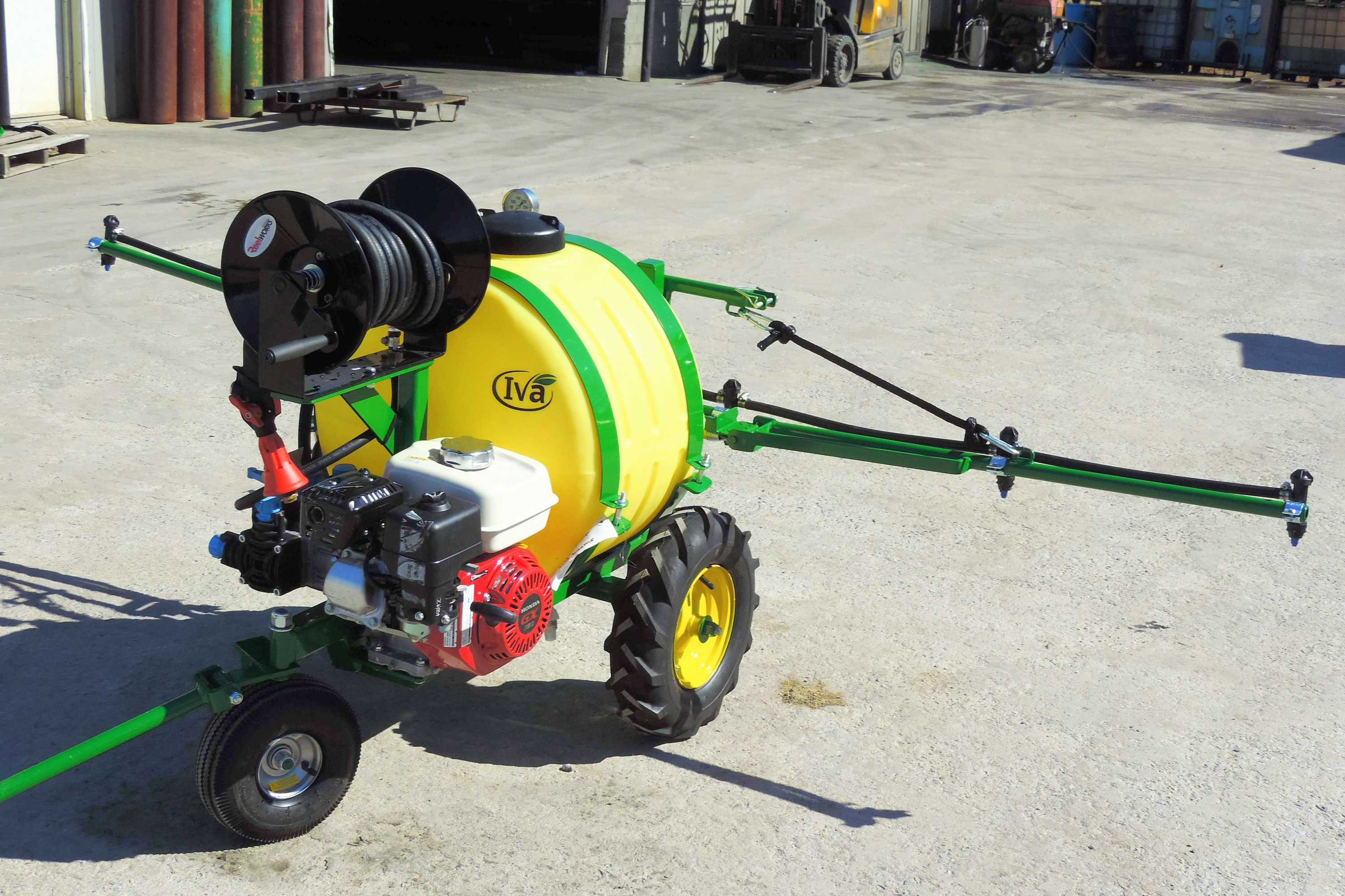 Orchard sprayer with 25 gallon tank and hose reel and spray wand