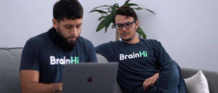 The Founders of BrainHi looking at a computer