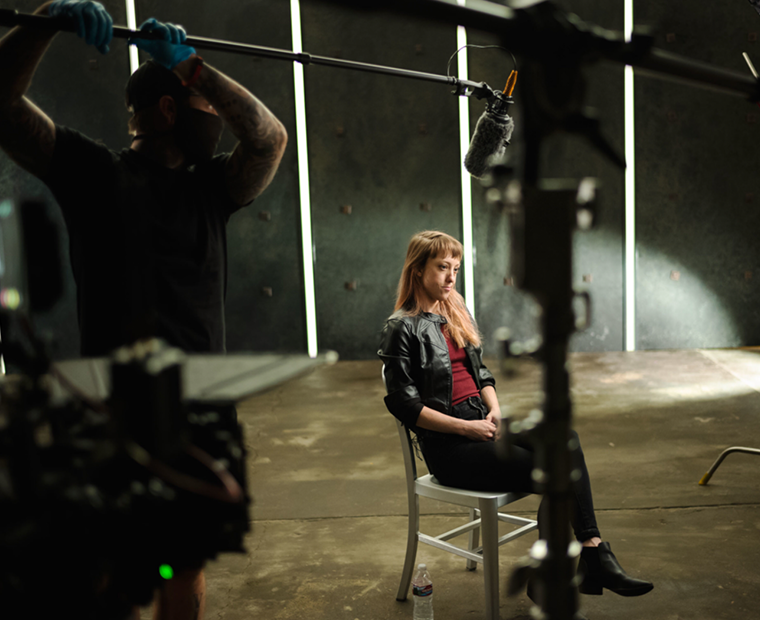 a woman in front on cameras on set