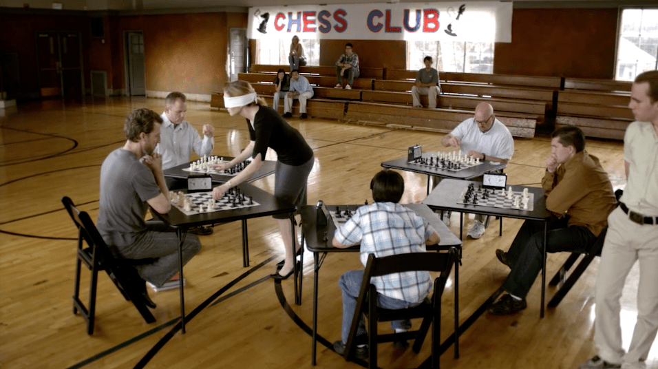 This Eleviv commercial shows many people playing chess. One woman does so in a blindfold.