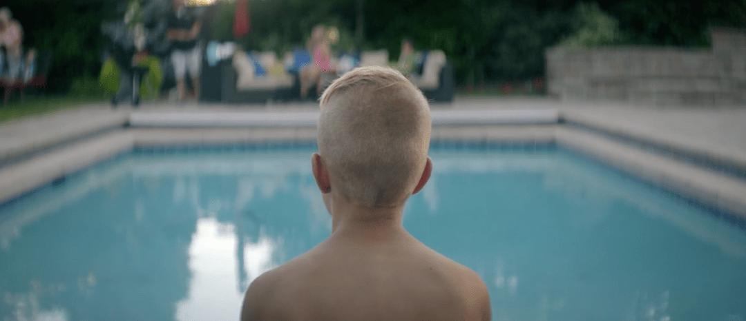 This Intermountain healthcare commercial follows a young boy named Alex's heart transplant story. Scenes depict him swimming in a pool and riding his bike.