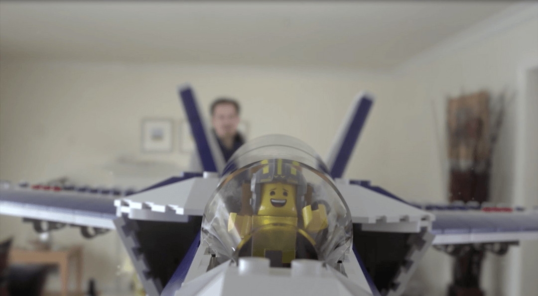 """This Lego """"Never Grow Up"""" spot features a father and son playing with Legos. the father throws a lego airplane and it glides through the air with it's lego passenger inside."""