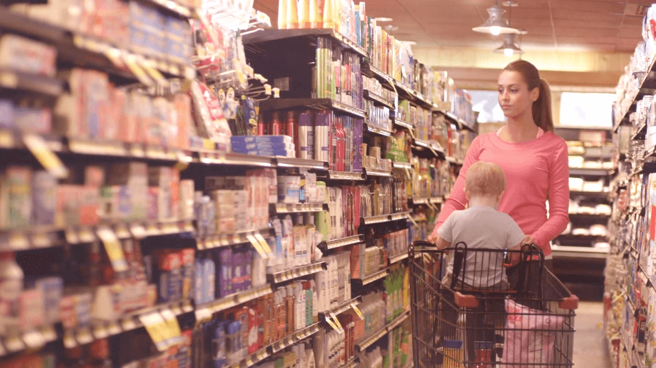 """This Modere spot """"Stop and Think"""" follows a woman and her infant son in a grocery store, browsing the aisles, a business man spending time with his family, women online shopping."""