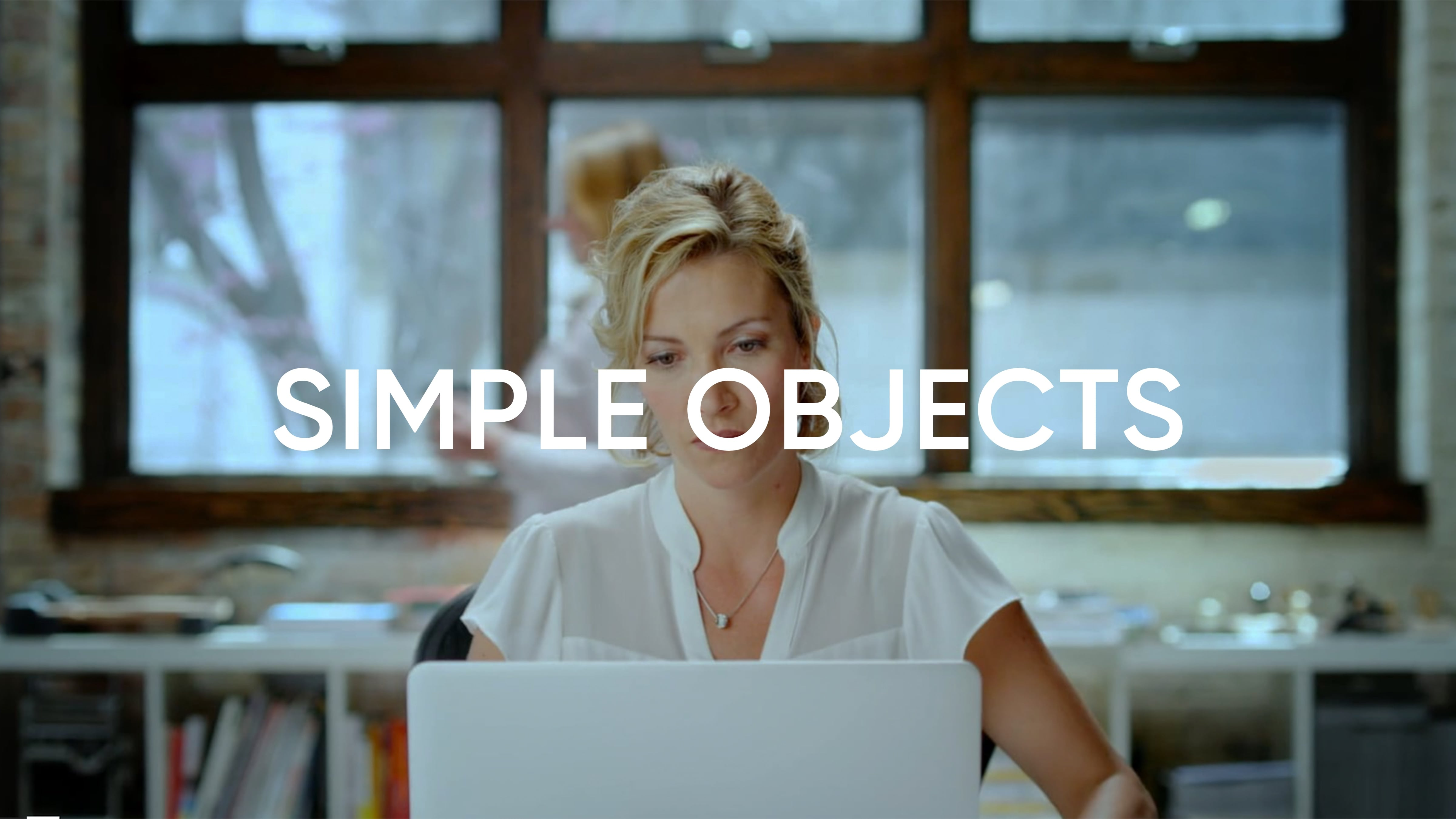 """This Sophos commercial """"Simple Objects"""" opens on a woman waking up early for work and getting ready.  In the office, she removes Malware from her computer and is relived."""