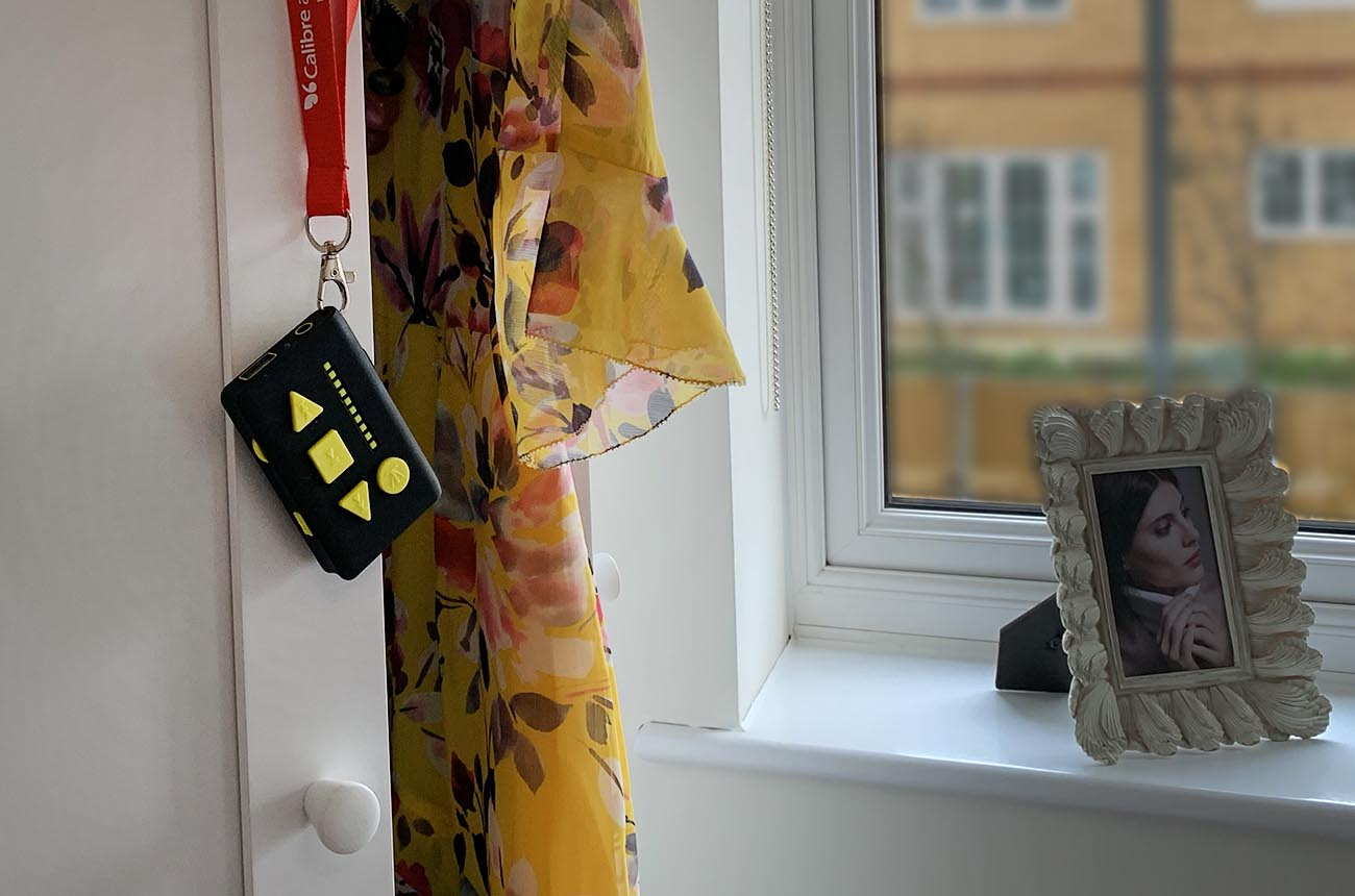 Image of the solo hanging by its lanyard on a cupboard door