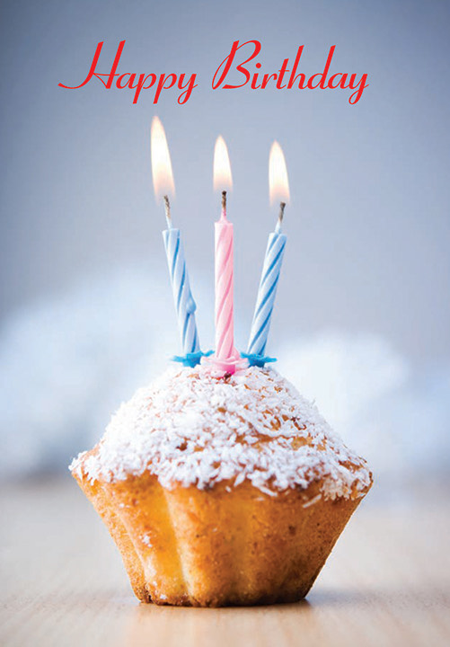 A photograph of a cupcake with three lit birthday candles. The words Happy Birthday are across the top of the card.