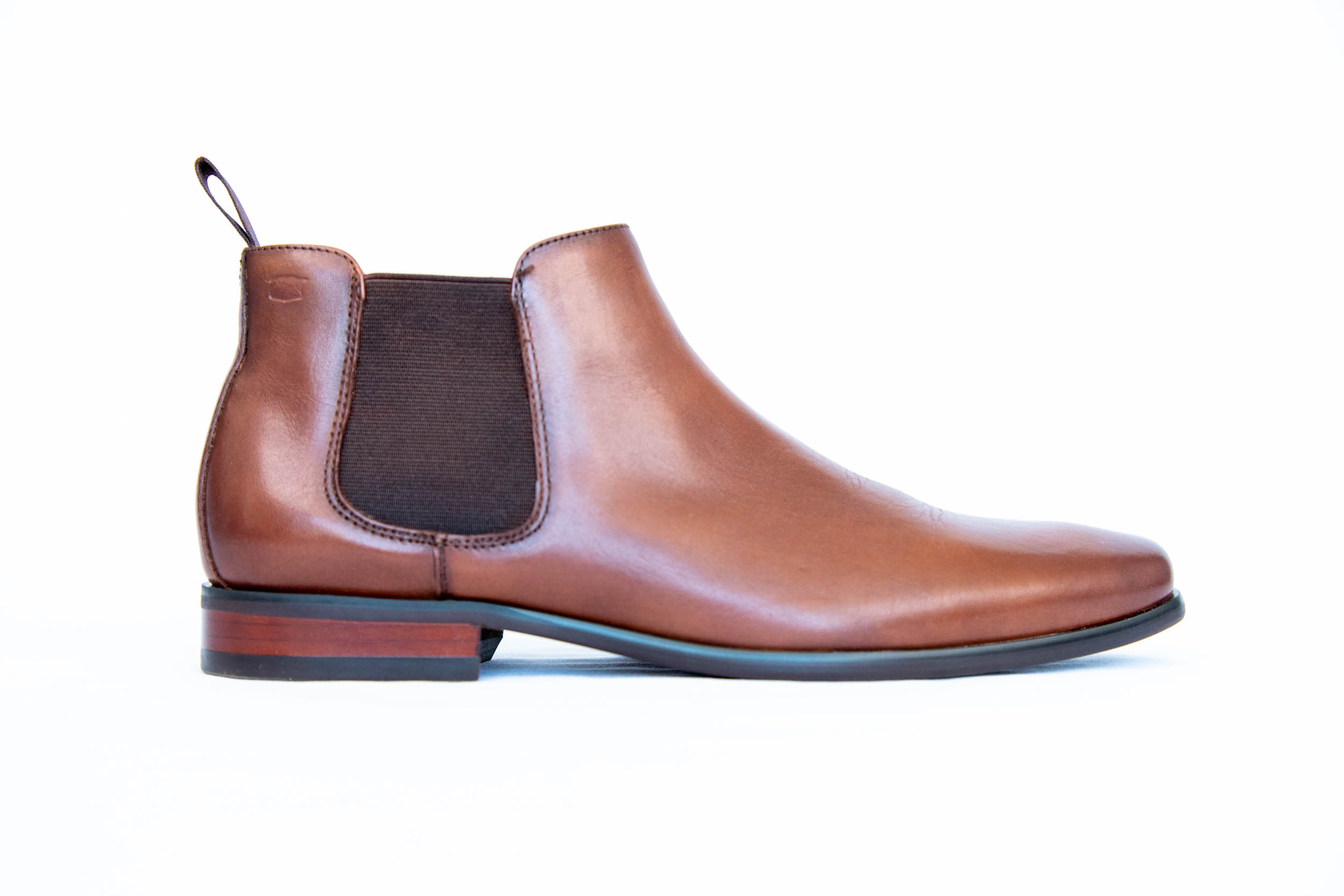 Product photography for Rundle Tailoring. A brown leather shoe against a white backdrop