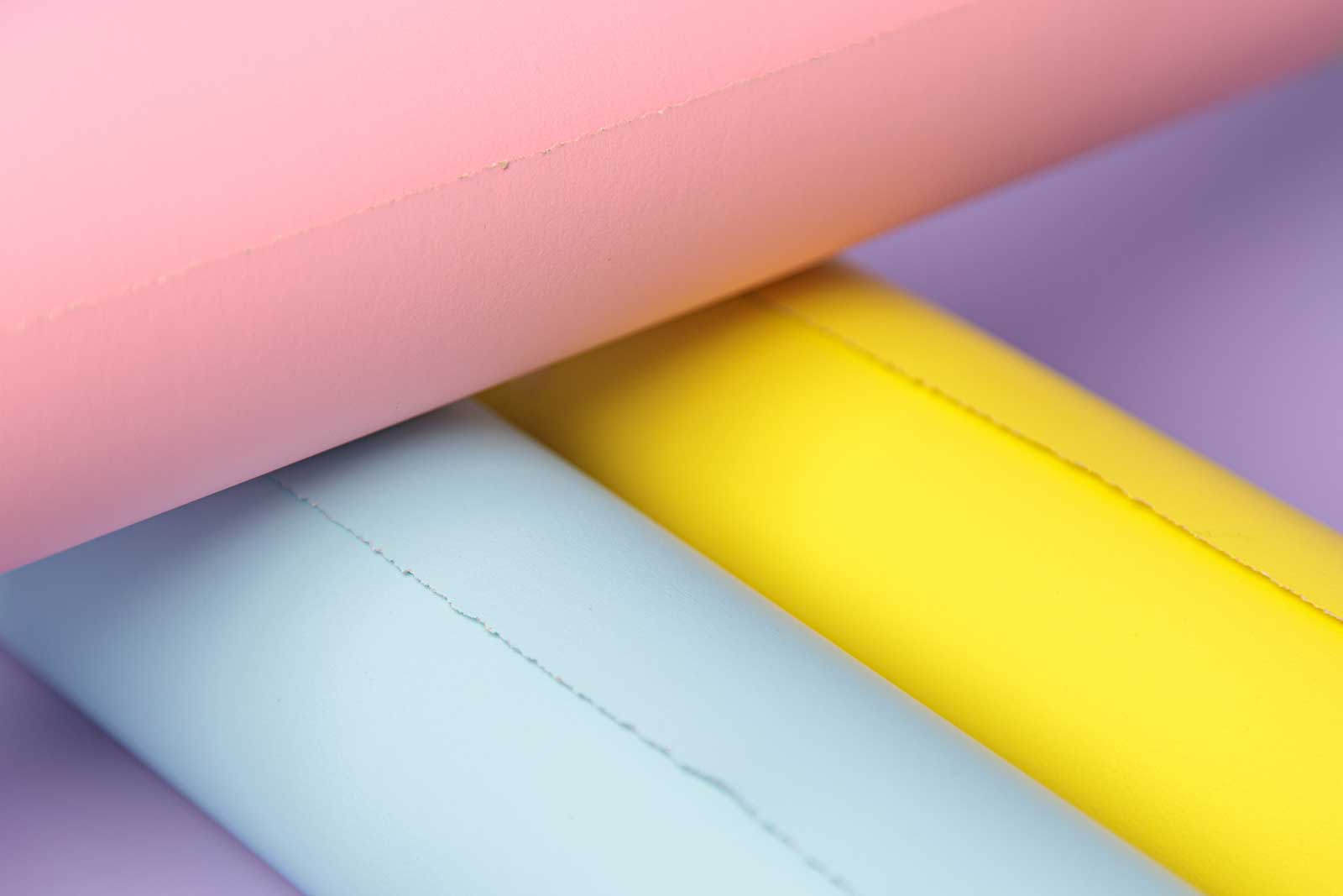 rolls of yellow, blue, pink and purple photography backdrops ready for shoots