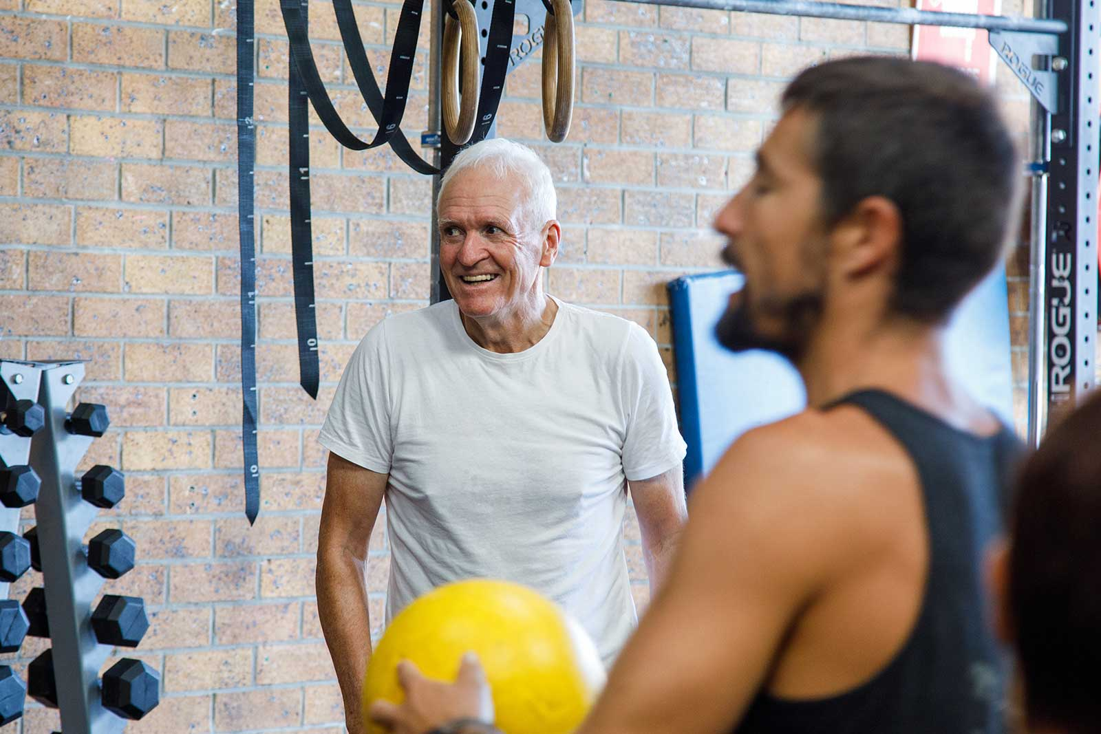 a man laughing and happy at a gym class.