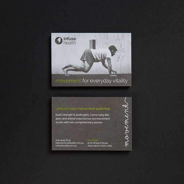the front and back of a flyer photographed on a black background.