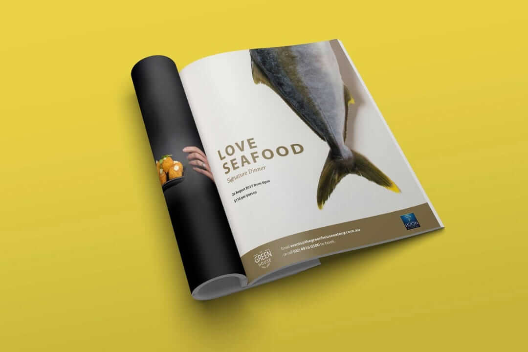 Print advert in a local magazine for a seafood event at a local restaurant. Using a whole kingfish on a pale white background.