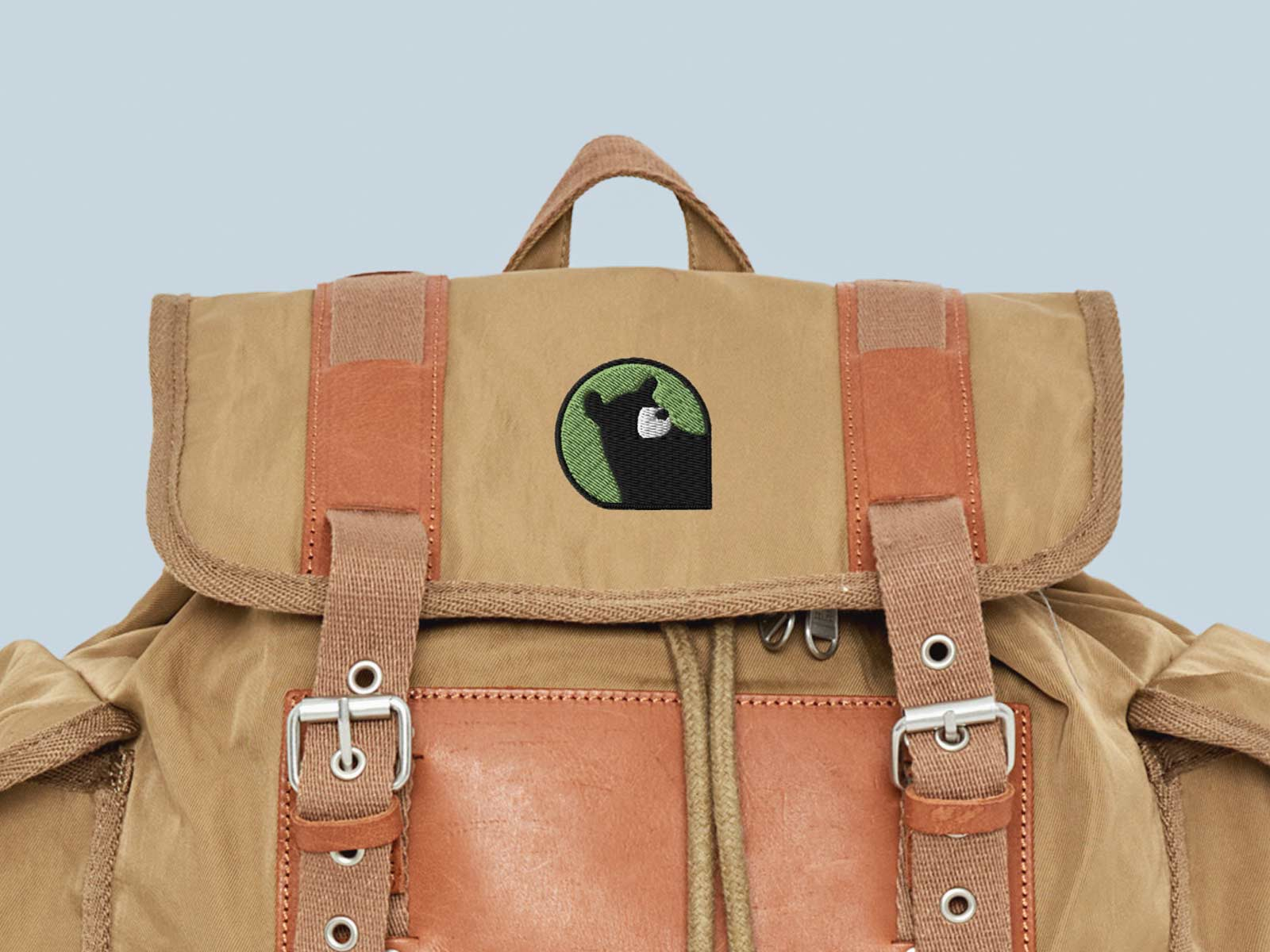 Embroidered Hey Bear Logo Design on Hiking Backpack by Lucas Bell
