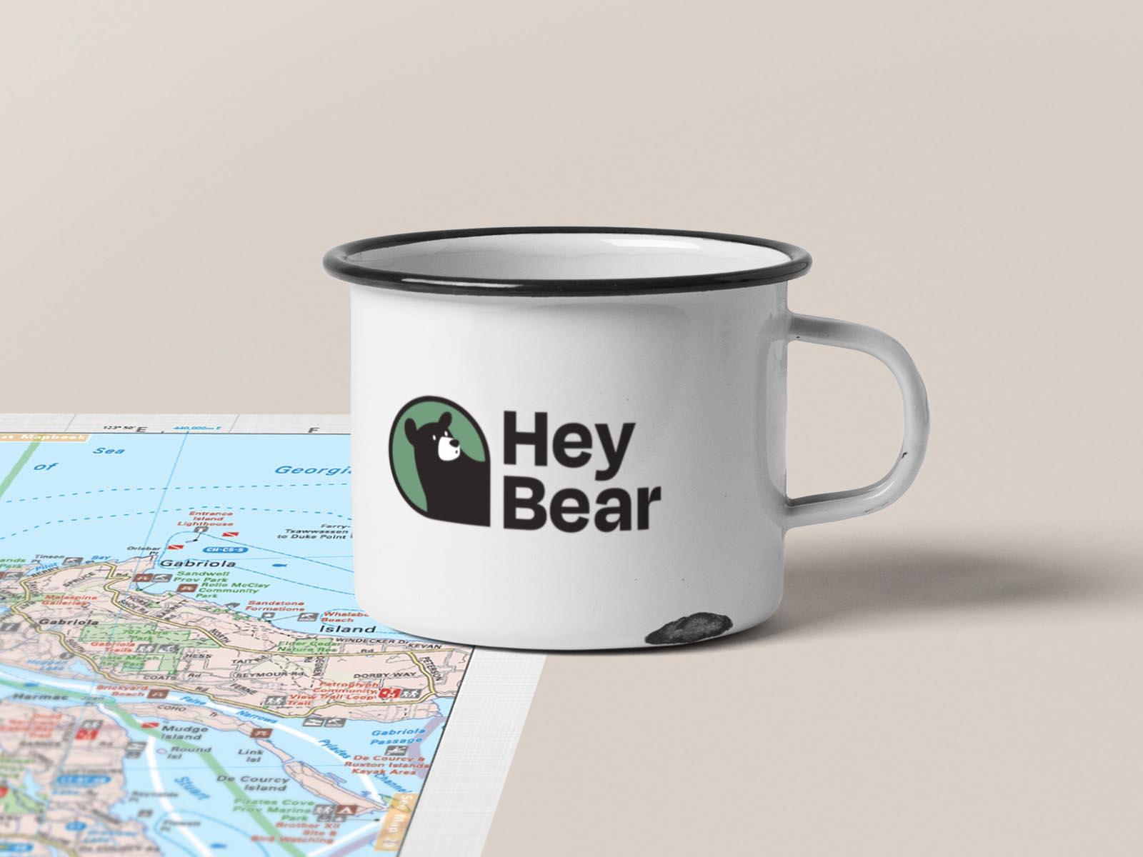 logo on travel mug for hey bear logo design project