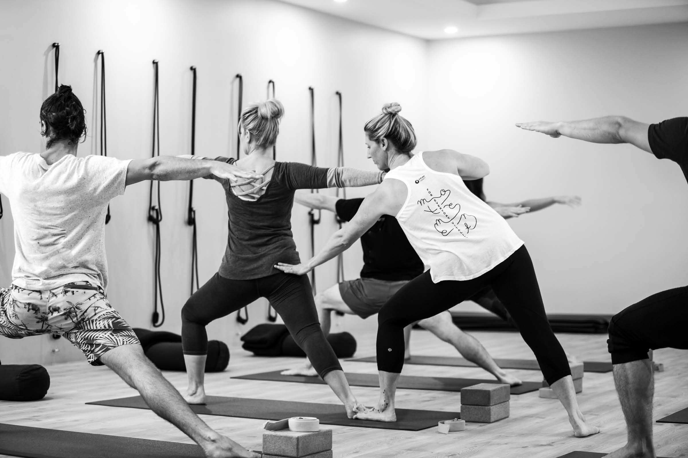 a photo shoot of Infuse Health staff teaching at their yoga studio in Adamstown