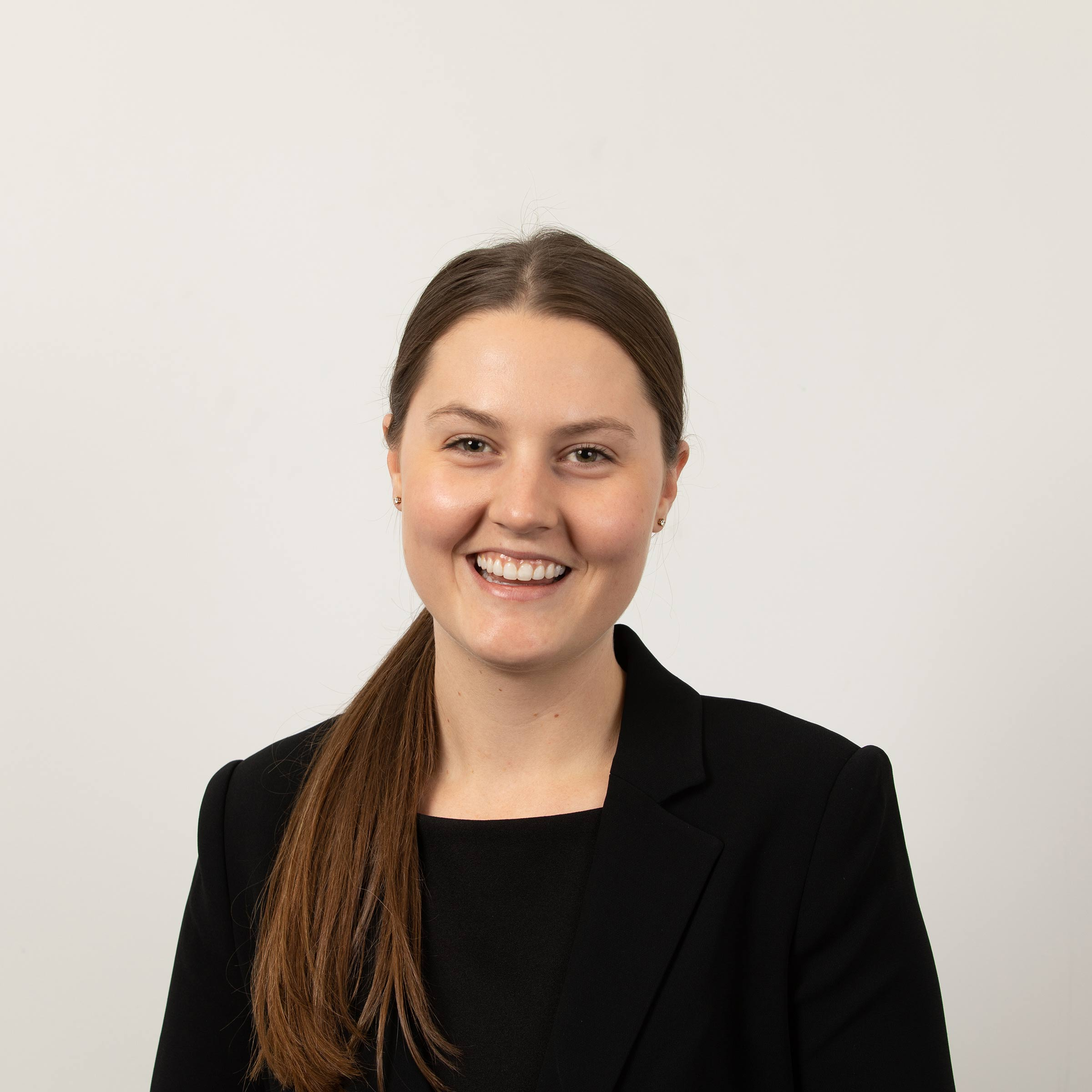 a natural corporate headshot of a staff member at the University of Newcastle
