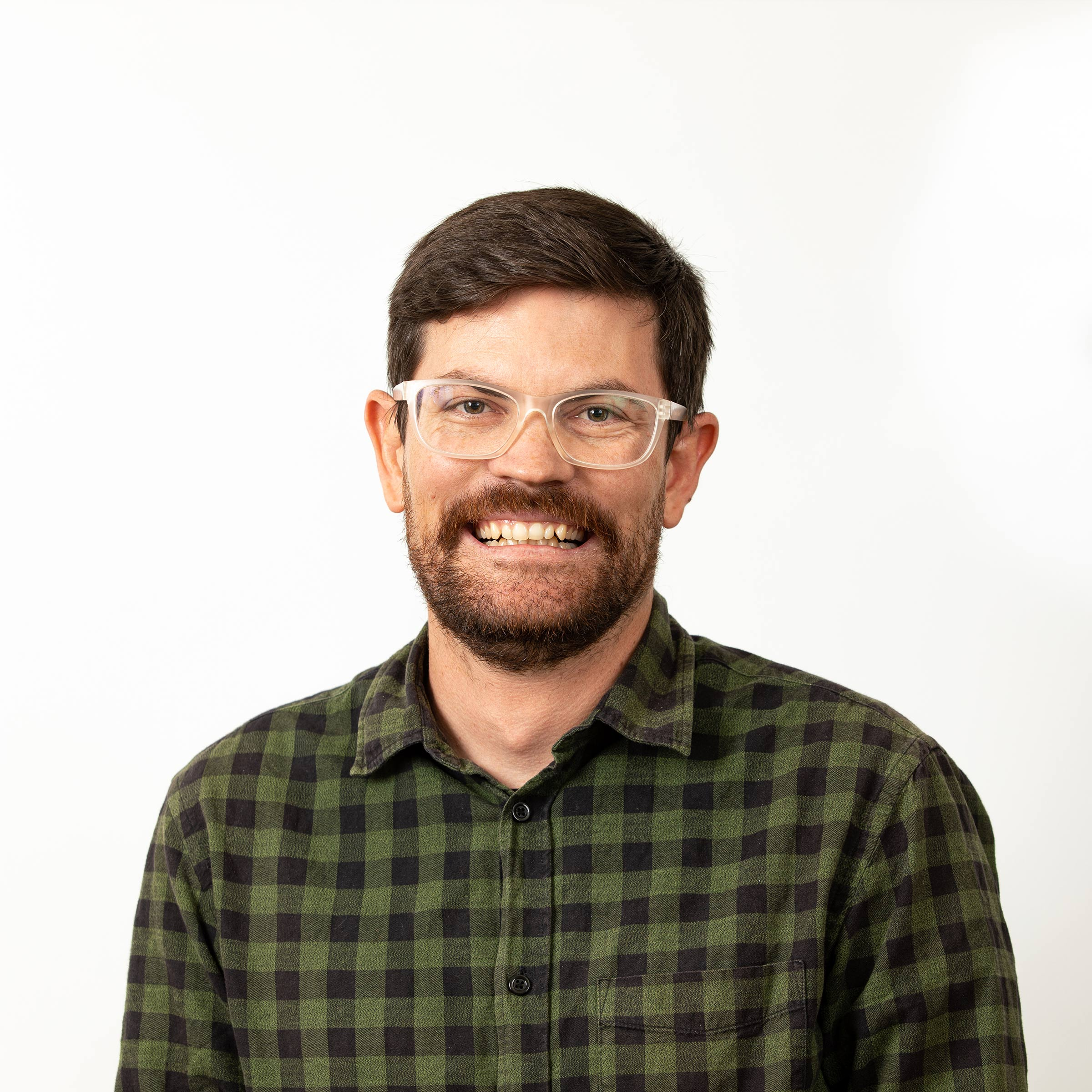 happy image of a man wearing glasses and looking directly at the camera