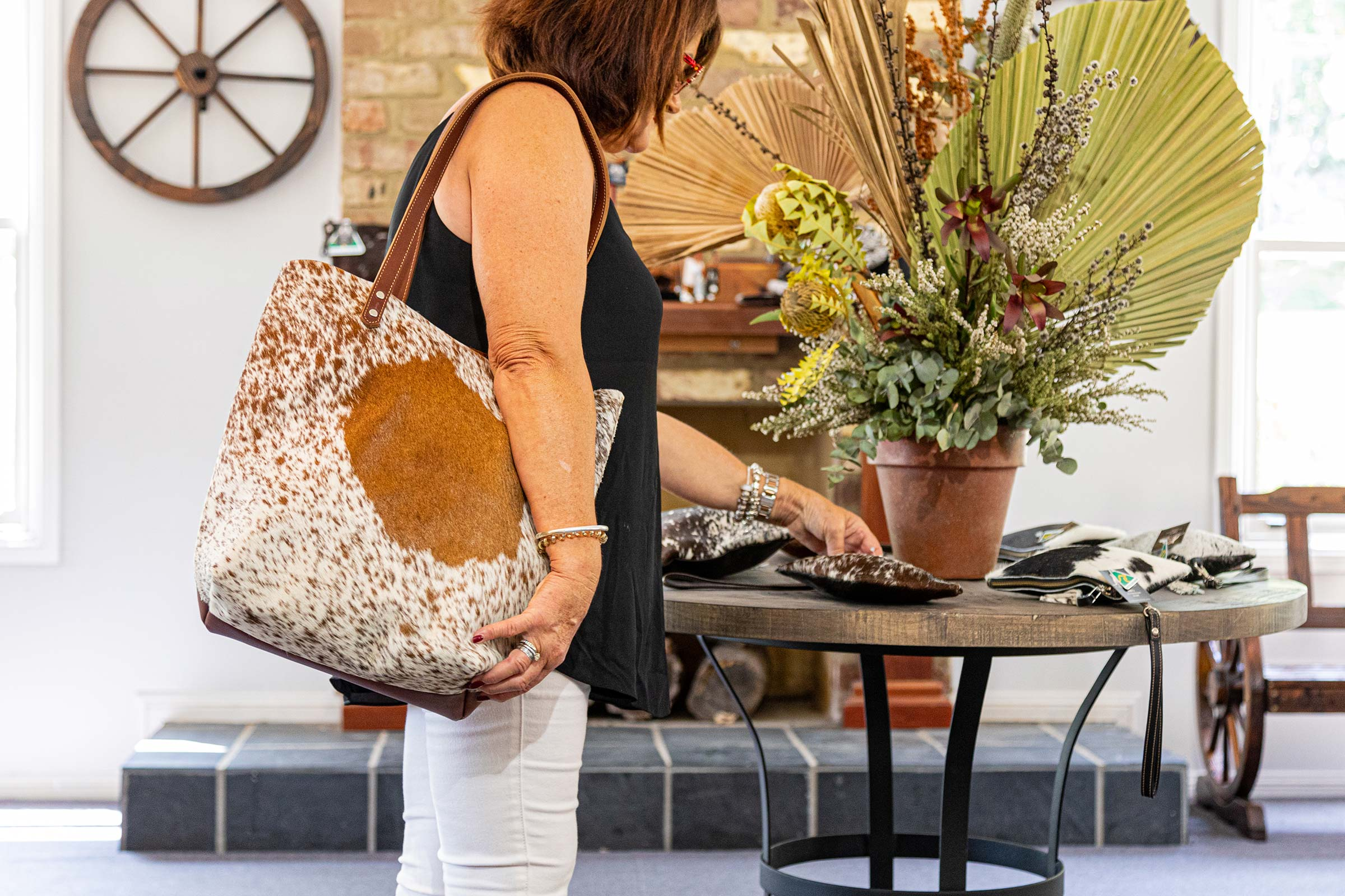 Photo of a lady shopping in the Hunter Valley, Australia. Looking at purses