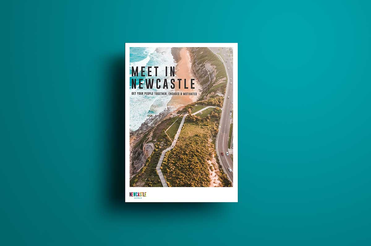 A City of Newcastle tourism guide. The headline reads Meet in Newcastle and there's an aerial image of Newcastle underneath the text.