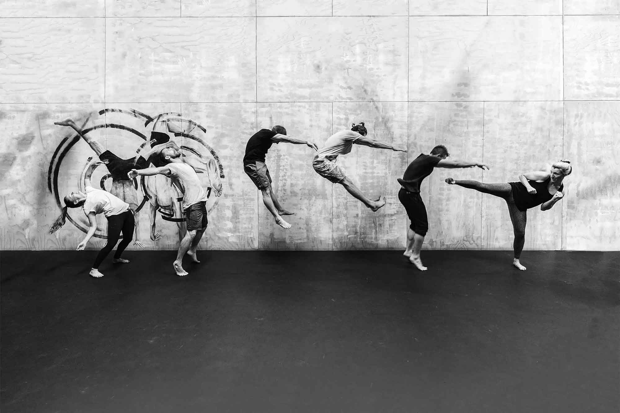 A photograph for Infuse health used on the intro page to their website. Featuring 6 people jumping to different heights.