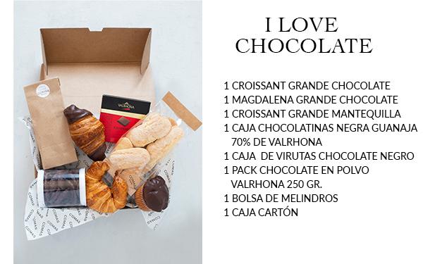 Pack desayuno con una selección exquisita de nuestros productos. Incluye: 1 croissant grande de chocolate, 1 magdalena grande de chocolate, 1 croissant grande de mantequilla, 1 caja de chocolatinas chocolate negro 70% guanaja Valrhona, 1 caja de virutas chocolate negro, 1 pack chocolate en polvo Valrhona 250 grm. 1 bolsa de melindros, 1 caja de cartón.