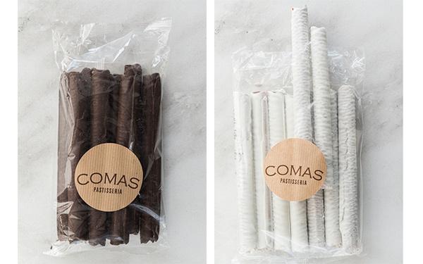 Neulas artesanas bañadas de chocolate negro o chocolate blanco.