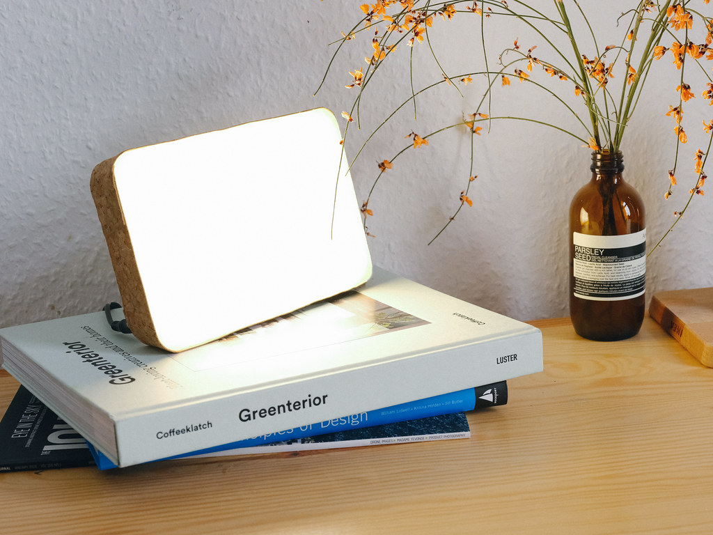 A SAD light therapy lamp on top of a stack of books