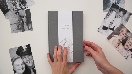an autobiography journal with prompts surrounded by old photographs