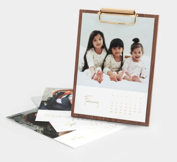 wooden desktop calendar with photo cards