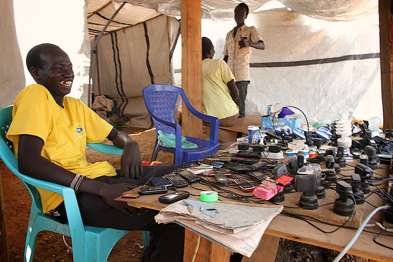File:Charging mobile phones and light bulbs is a business inside UN House, Juba (12317290513).jpg