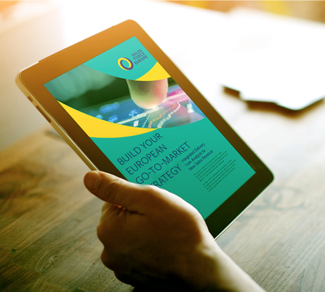 A person reading Salesforce Europe's eBook about building your European market strategy on a tablet.