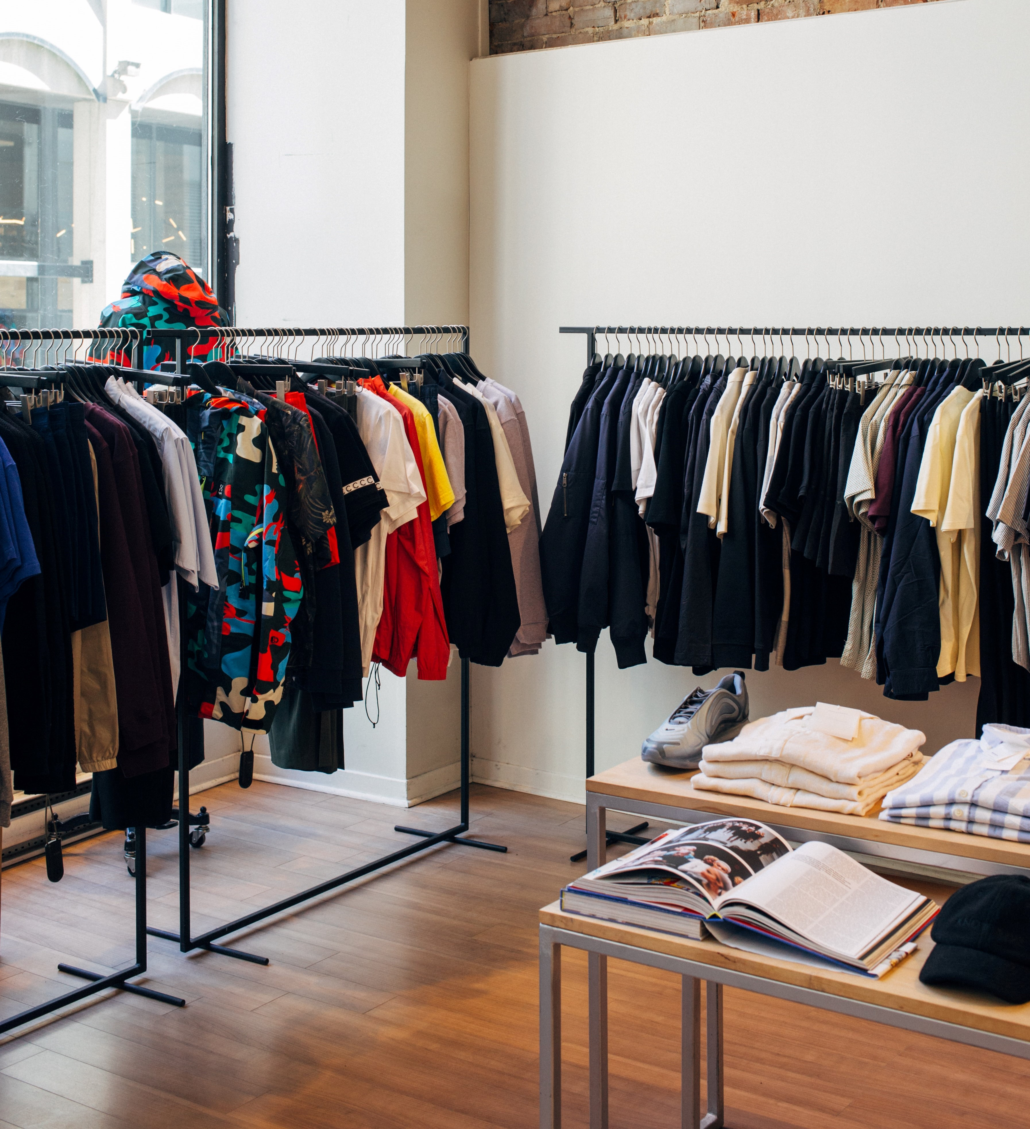 assorted-color clothes hanging on metal racks Photo by Charles Deluvio on Unsplash