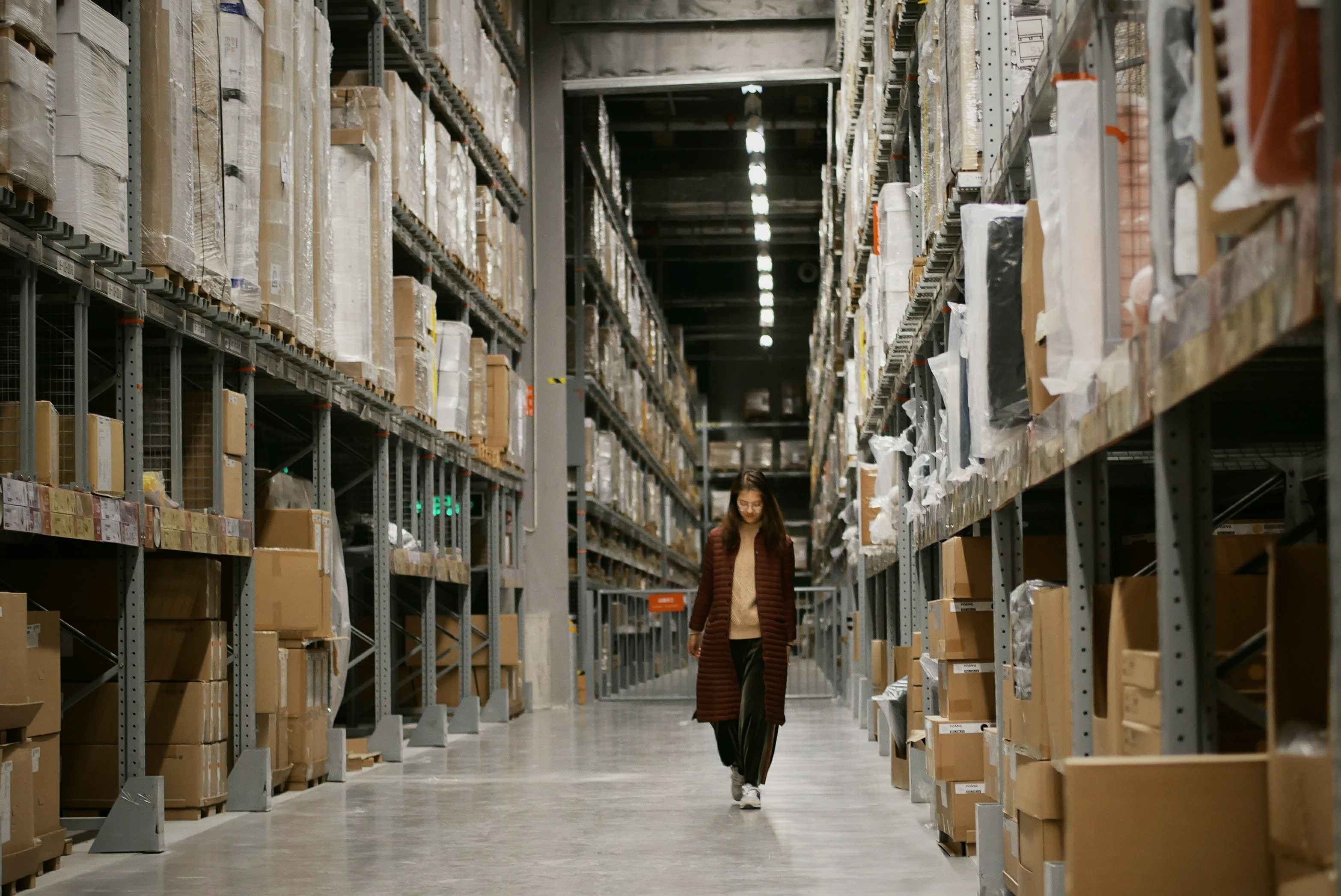 girl walking through warehouse Photo by Sikai Gu on Unsplash