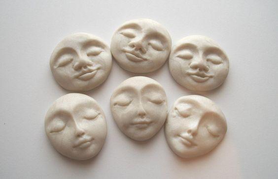 clay faces representing self esteem